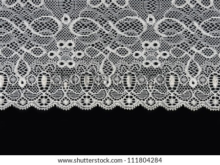 white lace with a floral pattern on a black background