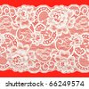 White lace with a floral pattern on a red background - stock photo