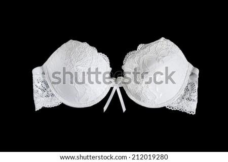 White lacy strapless push up bra on black background - stock photo