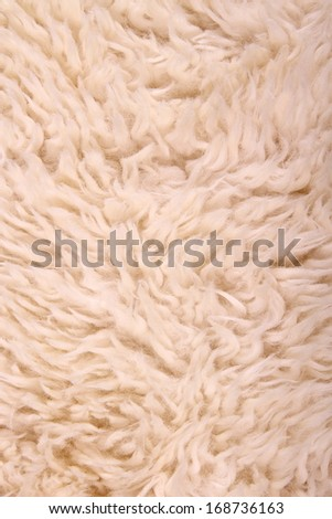 White lambskin as background, vertical and close up