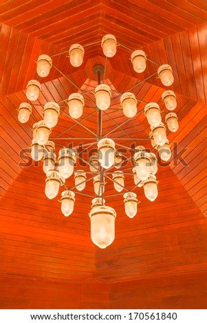 White lamp under brown wood ceiling - stock photo