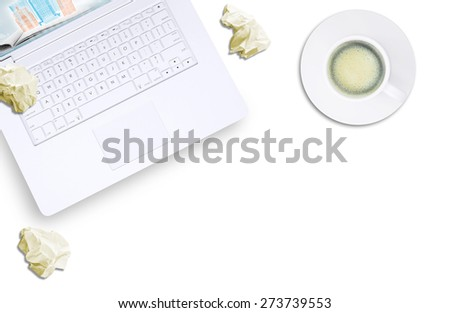 White laptop, espresso and crumpled piece of paper on isolated white background, top view. Closed up