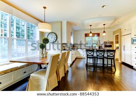 White large luxury modern kitchen with dark floor - stock photo