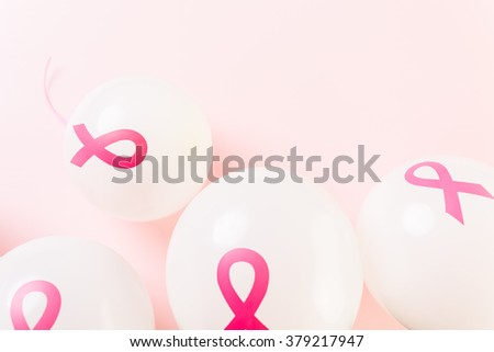 White latex balloos with pink reibbons.