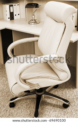 white leather armchair in a modern office