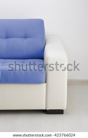 White leather sofa isolated against the wall - stock photo