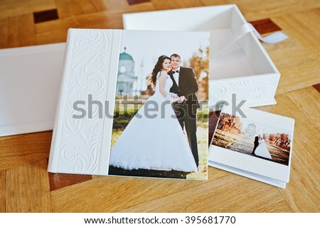 White Leather Wedding Book Or Album On Wooden Background