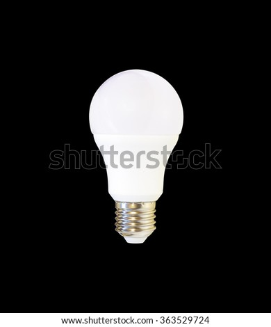 white LED light bulb isolated on black background with reflection