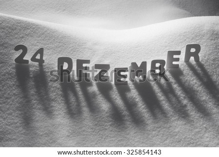 White Letters Building German Text 24 Dezember Means 24th December On White Snow. Snowy Landscape Or Scenery. Christmas Card For Seasons Greetings Or Usable As Background.