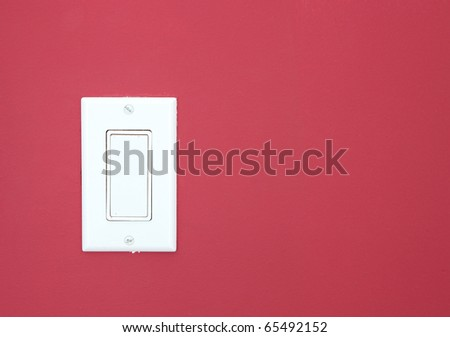 White light switch on the red wall - stock photo