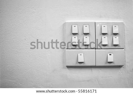 White light switch on wall - stock photo