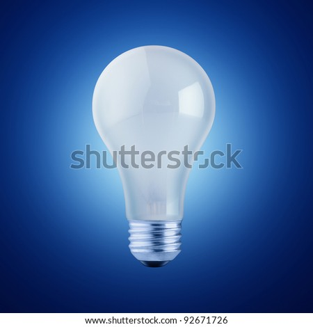 White  Lightbulb Isolated on Black Background - stock photo