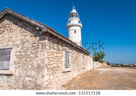 white lighthouse and the old house on the island of Cyprus