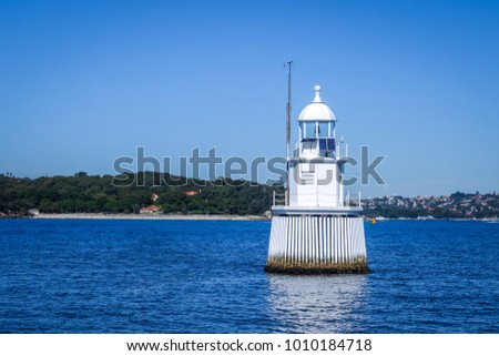 White lighthouse in the sea, Sydney bay, Australia