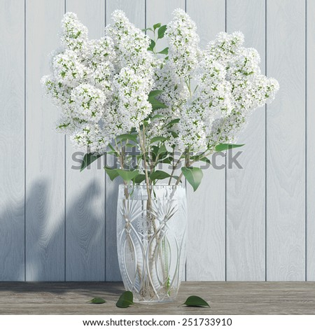 WHITE LILAC in a crystal vase _ BLUE BOARDS background - stock photo