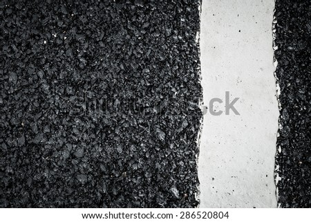 White line marking on road texture background