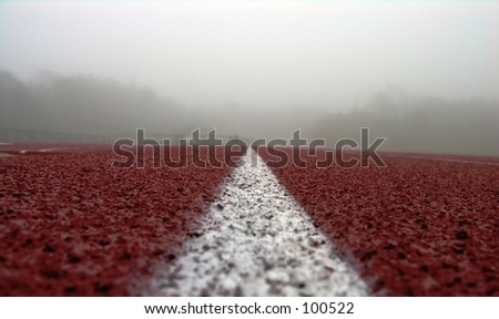 White line on red and fog - stock photo