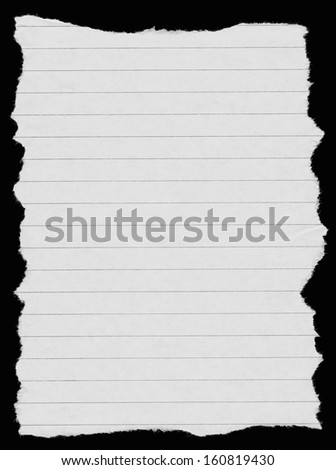 white lined paper isolated on deep black background, edges are very frayed - stock photo