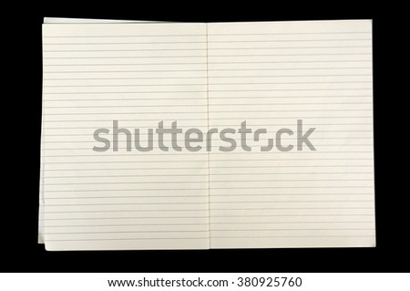 white lined sheet of notepad paper on black background - stock photo