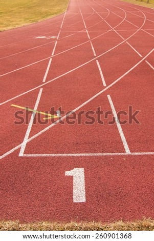 White lines and texture of running racetrack, red rubber racetracks in outdoor stadium - stock photo