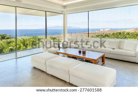 White living room in the modern villa with sea view