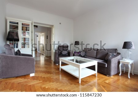 White living room with a purple furniture