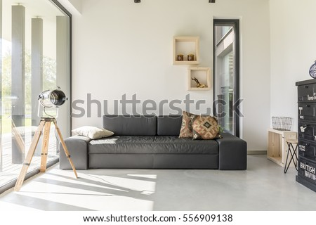 White Living Room With Black Furniture And Window Part 54