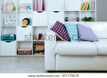 White living room with sofa and bookcase - stock photo