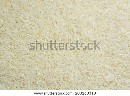 White long rice background, uncooked raw cereals