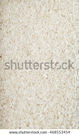 white long rice natural white long rice grains background, closeup