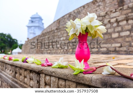 White lotus flowers offer at buddhist stupa - stock photo