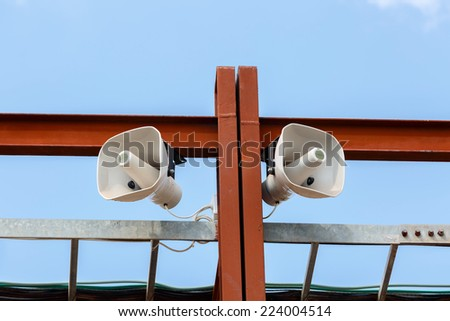 White loudspeakers on the brown metal construction - stock photo