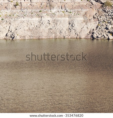 White low water level strip on red cliffs of Lake Mead entering Hoover Dam. - stock photo