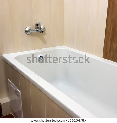 White luxury bathtub in bathroom with ceramic interior