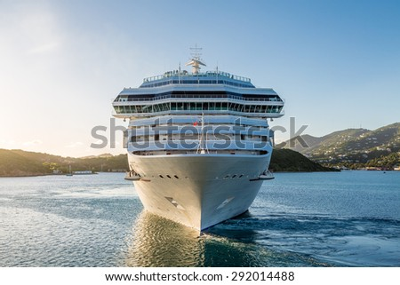 White Luxury cruise ship in bay from front - stock photo