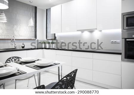 White luxury kitchen in contemporary house - stock photo