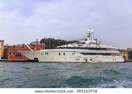 White luxury yacht near pier in Venice, Italy