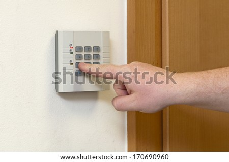 white man enters the code access - stock photo