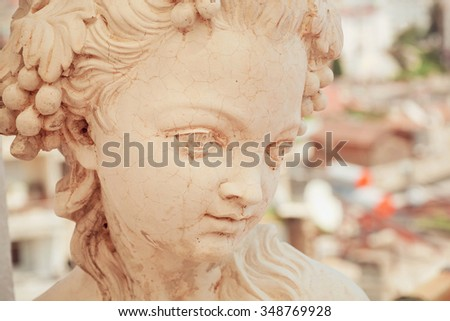 White marble head of young woman. Copy of rustic antique sculpture by an unknown author - stock photo