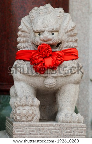 white marble lions Chinese temple in Thailand - stock photo