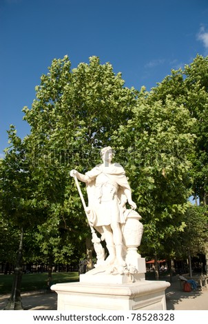 White marble statue in Tuileries garden�City Paris France. The Tuileries Garden (Jardin des Tuileries) is surrounded by the Louvre, the Seine, the Place de la Concorde and the Rue de Rivoli. - stock photo