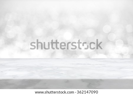 White marble stone countertop on blue bokeh abstract background  - can be used for display or montage your products - stock photo