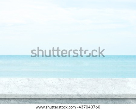 white marble table top. white marble table top with blurred sea and blue sky at background, mock up template n