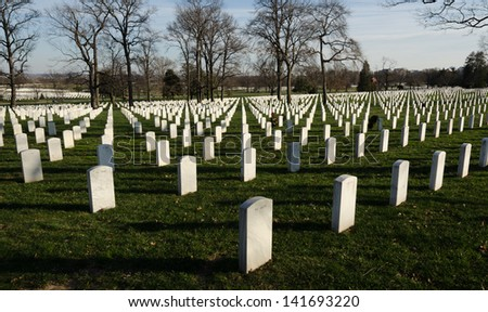 White marble tombstones at Arlington National Cemetery - stock photo