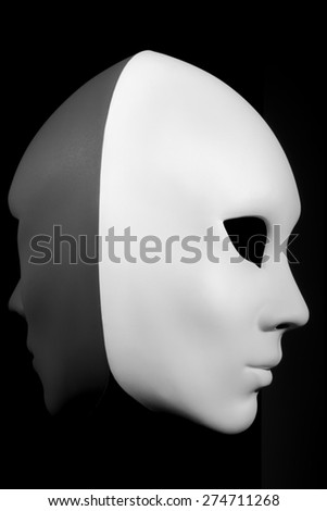 White mask for human face isolated on black