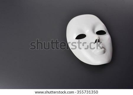 white mask on grey background - stock photo