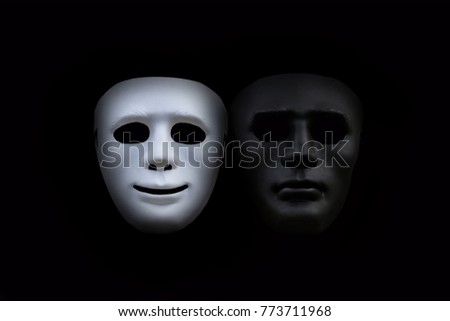White mask smiling at the angry black mask.