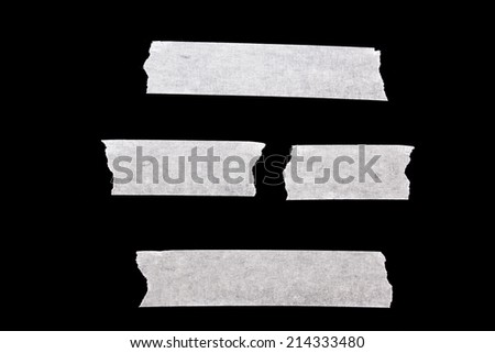 White masking tape isolated on black background. - stock photo