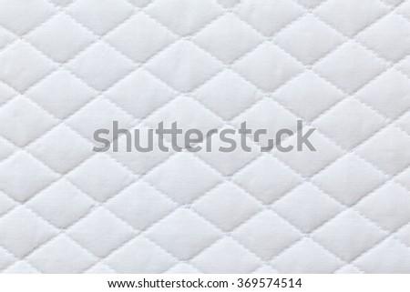 white mattress bedding pattern background - stock photo