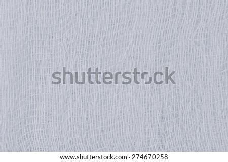 White medical bandage gauze texture, abstract textured background macro closeup, natural cotton linen fabric copy space in light blue - stock photo